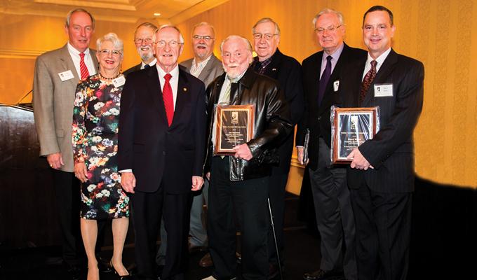 (Front row) Patty Nicoson, Ken Plum, Joe Stowers; (Back row) Keith Meurlin (representing Leo Schefer), John Milliken, Jim Larsen, Hollister Cantus, Phil Tobey, and Mark Watts