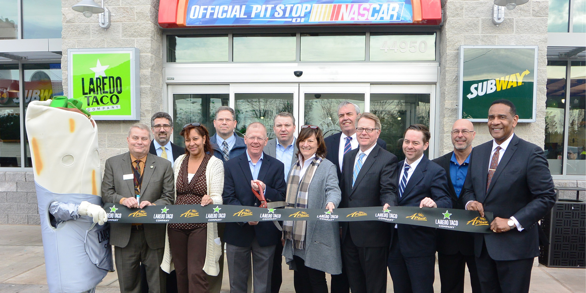 Sunoco Ribbon Cutting: Rich Bensinger, Loudoun County Department of Economic Development Business Development Manager; Jeff Shields, Sunoco LP Communications Manager; Christel Hair, Capital Area Food Bank Senior Director of Strategic Partnerships and Community Engagement; Chris Beausoleil, Dulles International Airport Project Manager; Scot Knox, Sunoco LP Regional Operations Director; Patrick Dillon, Sunoco LP Director of Retail Operations; Ruth Clauser, Sunoco Foundation President; Jack Potter, Airports Authority President and CEO; Jim Poff, Airports Authority Director, Real Estate; Bill Jenkins, Airports Authority Real Estate Analyst; Russell Ramsey, Sunoco LP Area Operations Manager; Jerome L. Davis, Airports Authority Executive Vice President and Chief Revenue Officer