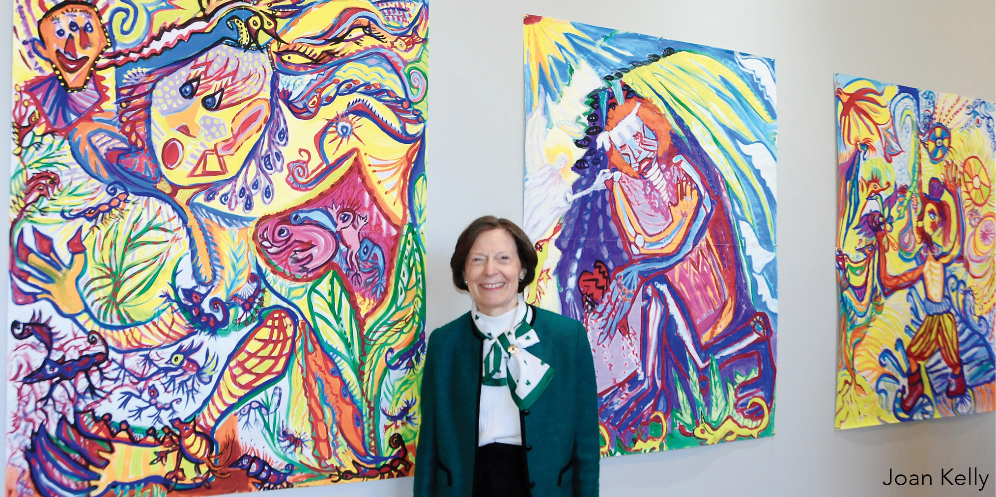 Joan Kelly with her paintings
